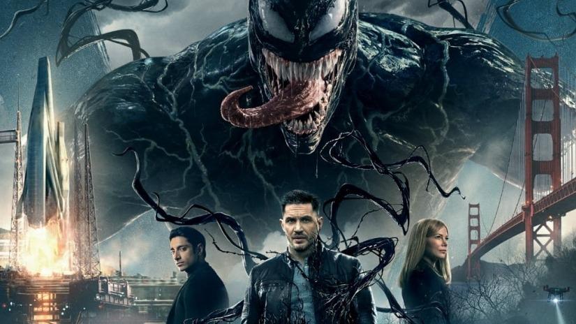 Venom, a monster above three people
