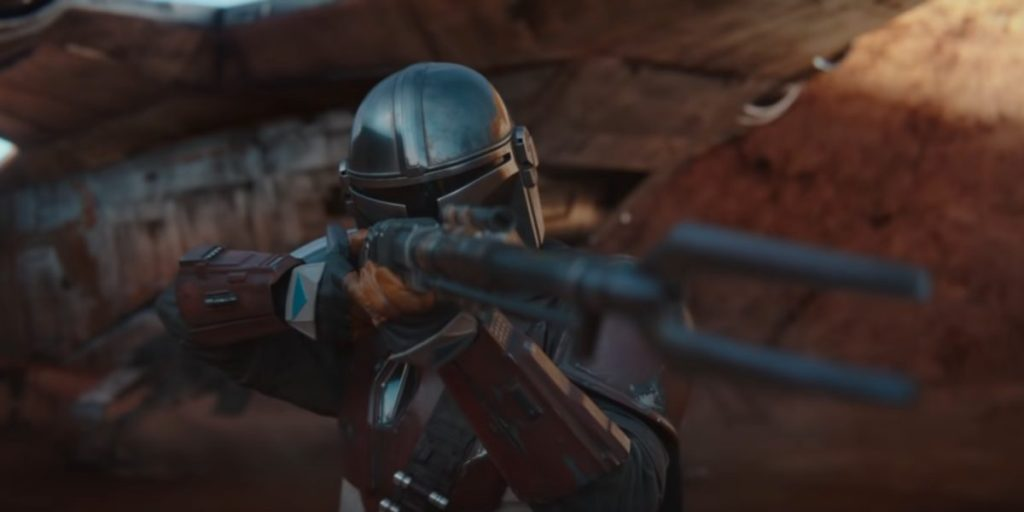 The Mandalorian, a man with a rifle