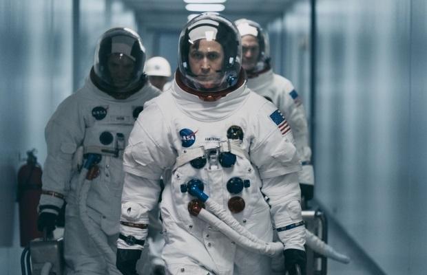 Three men in spacesuits