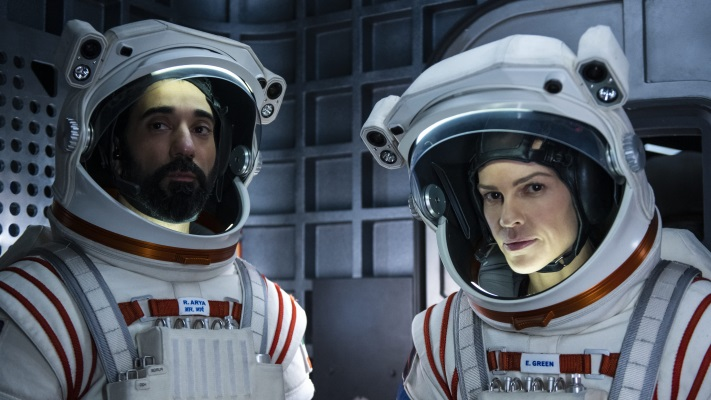 Away, two people in spacesuits